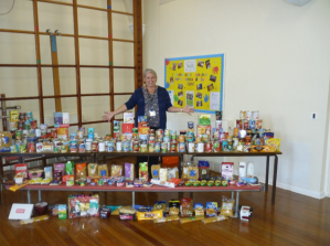 Netherthong Primary School's Jo Moran shows food donations
