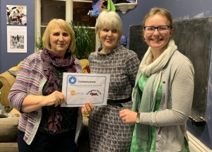 Smiles all round when Liz & Lorraine receive the cert from Katie Kemp